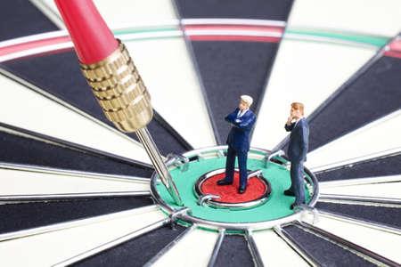 strategizing: Businessman figurines placed on a dartboard