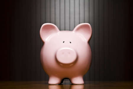 Piggy bank on a table Stock Photo
