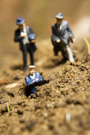 Business figurines placed outside in the dirt Stock Photo - 7282350