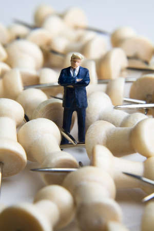 strategizing: Businessman figurine placed with tacks