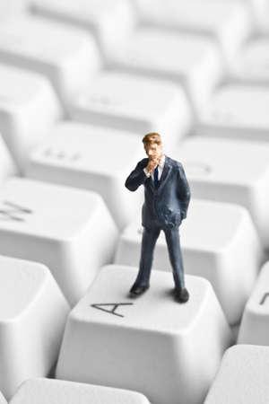 strategizing: Businessman figurine placed on computer keyboard