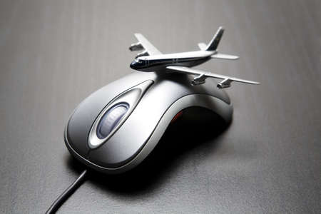 purchase order: Toy airplane placed on a computer mouse