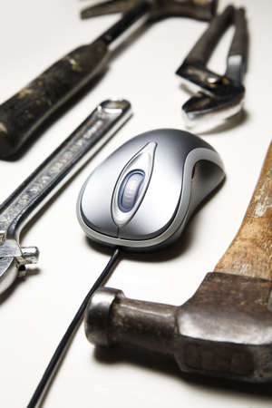 computer mouse and old tools photo