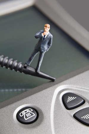 strategizing: Businessman figurine placed on a PDA