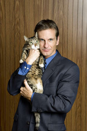 Businessman holding a cat