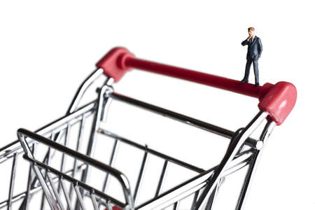 loaning: Businessman figurines on a shopping cart