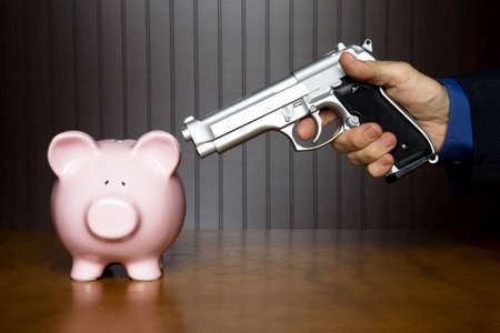 heist: Man pointing a gun at a piggy bank