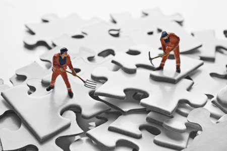 worker figurine on puzzle pieces Stock Photo - 7792968