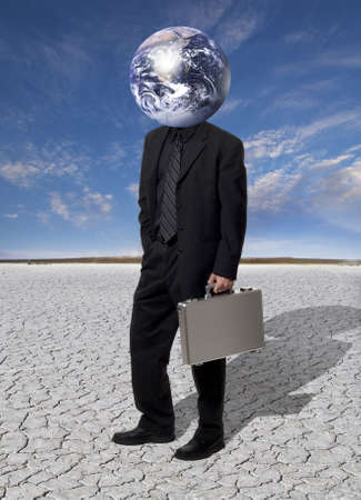 Businessman with an earth globe for his head. Stock Photo