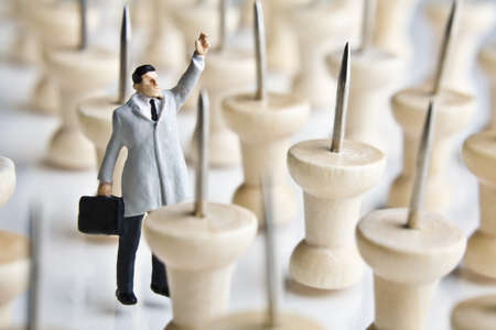 strategizing: Businessman figurine with tacks  Stock Photo
