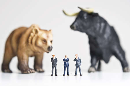 bearish market: Business figurines placed with bull and bear figurines.