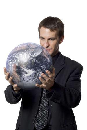 Businessman holding an earth globe.