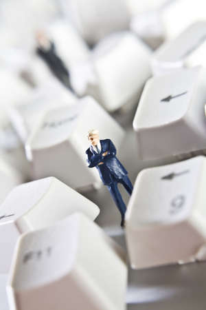 Business figurines placed with keys from a computer keyboard