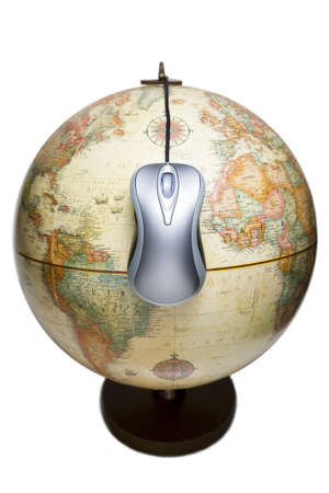 Metallic computer mouse hanging on an earth globe