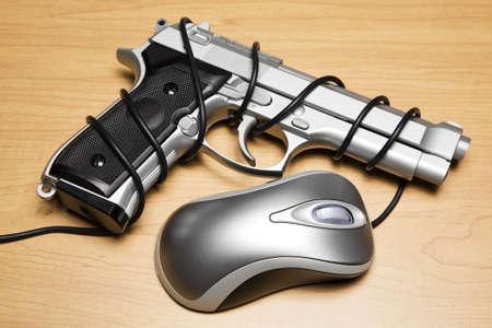 Computer mouse cord tied around a gun