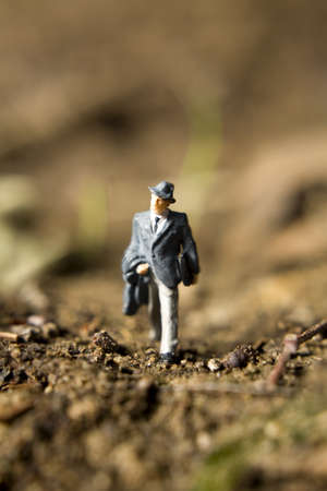 figurines: Business figurines placed outside in the dirt