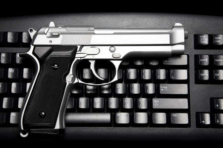 Handgun and computer keyboard Stok Fotoğraf - 7989717
