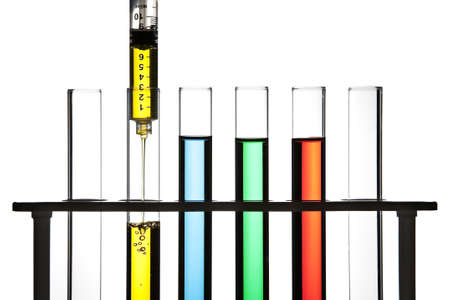 fda: Row of test tubes filled with colored fluid, syringe filling one test tube.