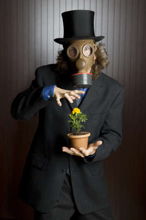 gasmask: Businessman wearing a gasmask holding a flower