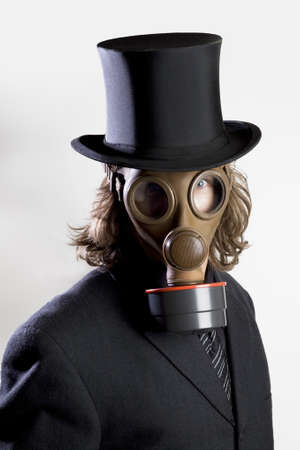 noxious: Businessman wearing a gas mask and a top hat