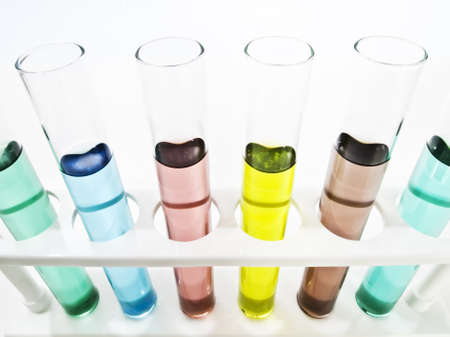 specimen testing: Test tubes filled with colored fluid  Stock Photo
