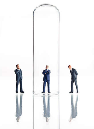 Business figurines placed in and around test tubes  Stock Photo - 11132778