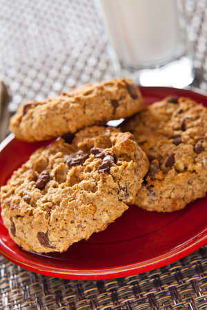 biscuits: Chocolate chip oatmeal cookies and a glass of milk