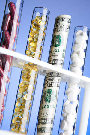 test tubes: pills, vitamins and money in test tubes