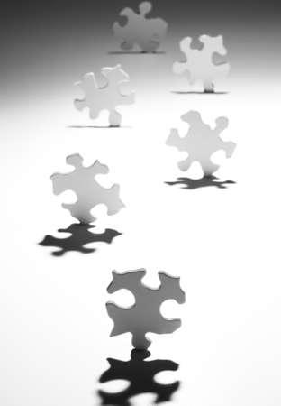 conundrum: Puzzle pieces casting shadows