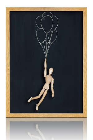 Manikin, anatomical model, placed on a chalkboard with balloons drawn on it  Stock Photo