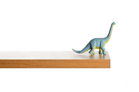 out dated: Dinosaur figurine placed on a ledge