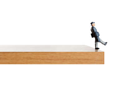 edge of cliff: Business figurine walking off a ledge