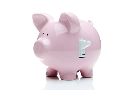 Turn on the savings  Piggy bank with a light switch  Stock fotó