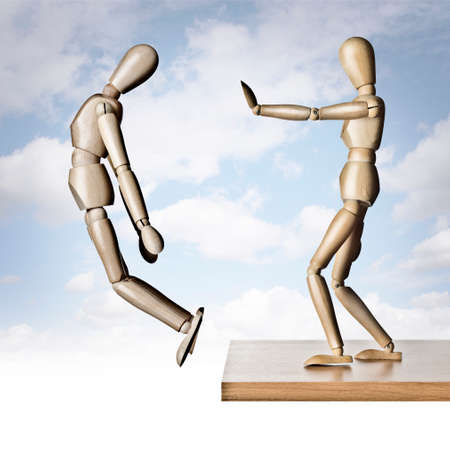 encourage: Two manikins, one pushing the other off an edge