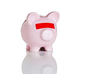 fondos negocios: Hucha con cinta roja sobre los ojos