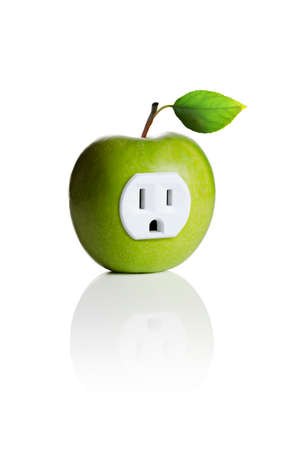 A green apple with an electrical outlet