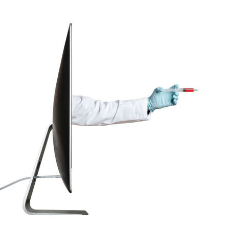 Hand holding syringe, extending out from a computer screen