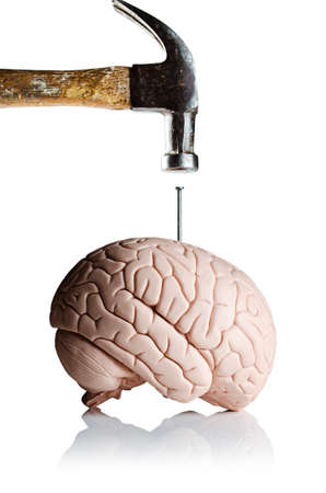 A hammer and nail with a brain model