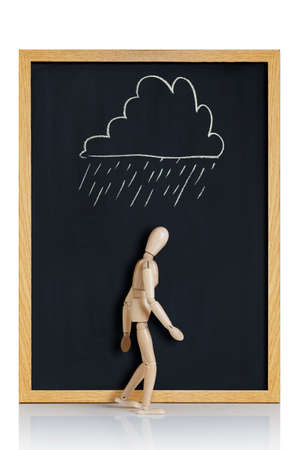 despondency: Manikin, anatomical model, placed on a chalkboard with a cloud drawn on it  Stock Photo