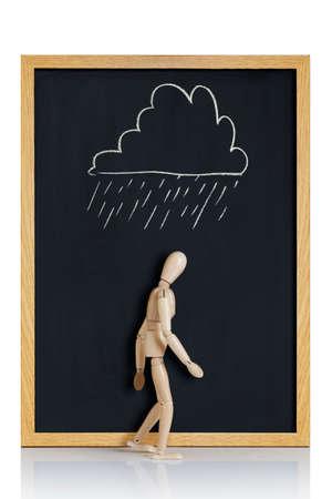 desolaci�n: Maniqu�, Modelo anat�mico, colocado en una pizarra con una nube dibujada en �l Foto de archivo