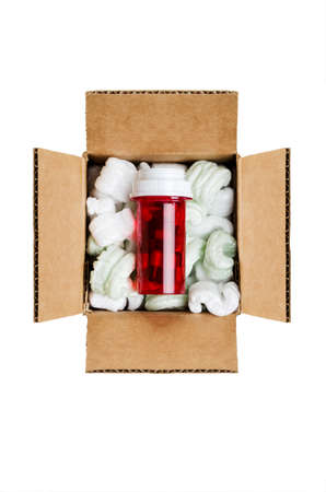 Pill bottle in a box with packaging peanuts