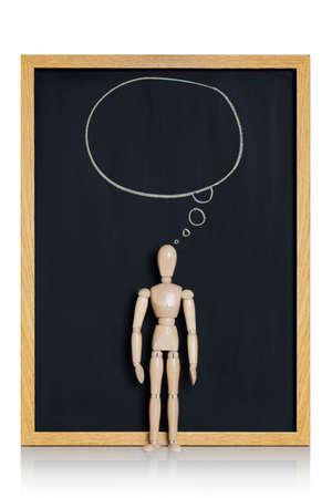 Manikin, anatomical model, placed on a chalkboard with a cartoon ballon drawn