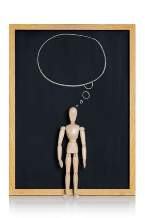 reflection of life: Manikin, anatomical model, placed on a chalkboard with a cartoon ballon drawn