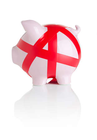 Piggy bank wrapped with red tape