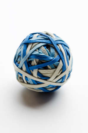 rubberband: Rubber band ball on white tabletop