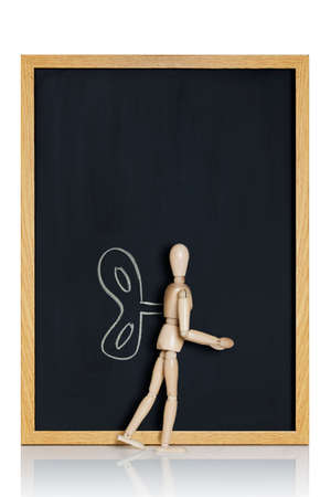 anatomical model: Manikin, anatomical model, placed on a chalkboard with a lever drawn on it  Stock Photo
