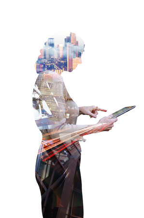Businesswoman using a computer tablet composited with a cityscape of Los Angeles photo