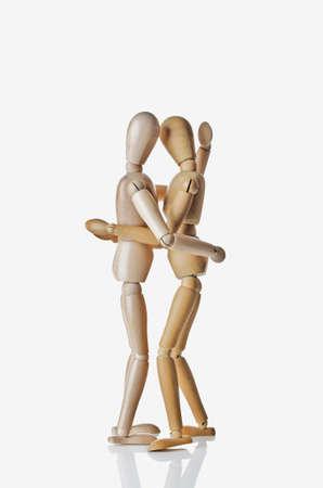 woden: Two Manikins Embracing Stock Photo