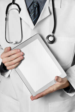 Doctor with stethoscope holding a computer tablet