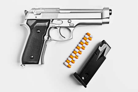 Gun with pills for bullets